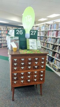 The seed library is located next to adult non-fiction.
