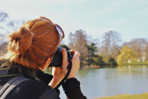 Girl in the park with a camera