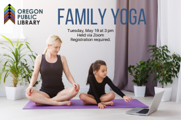 mother and daughter on yoga mat looking at computer, family yoga tuesday, may 19 at 3 pm